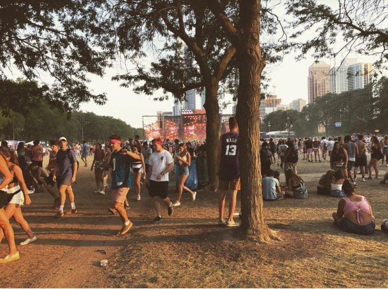 People+walk+around+the+music+festival.+Lollapalooza+was+a+music+festival+in+Chicago.