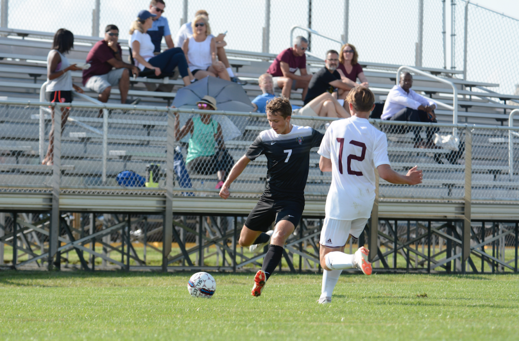 The soccer team prepares to face Lawrence North Aug. 25. Ben Price during the scrimmage against Brebeuf Aug. 8.