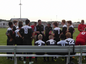 The boys soccer team huddled up during their game against Pike. The boys soccer team started their season with a victory against Warren Central.
