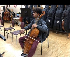 A student practices in orchestra class before the pandemic. This year students have been forced to practice at home.