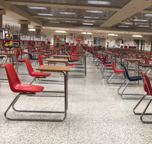 Classroom desks replace tables as students prepare to return.