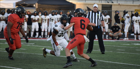 Quarterback Zayd Vestal looks to pass the ball during the Panther victory against Warren Central three weeks ago. North Central beat Carmel last year at their homecoming by a touchdown. The Panthers look to defeat the Greyhounds for the second year in a row tonight.