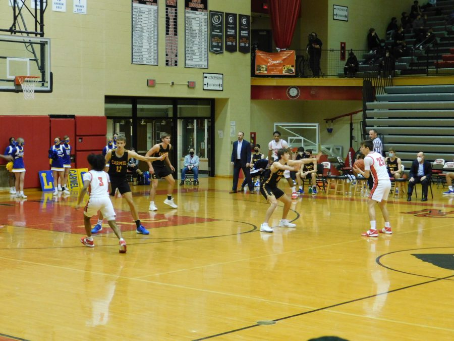 The boys basketball team in action during winter break. The team is currently 6-6 on the season.