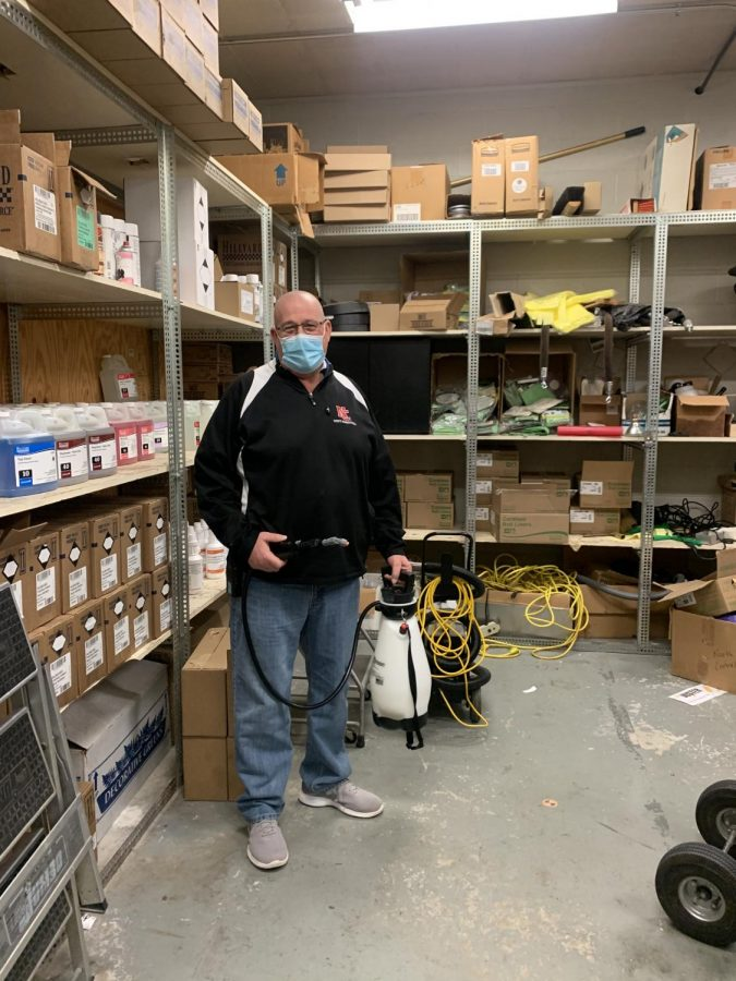 Custodian+Mike+Weaver+%0Asprays+down+equipment.+Weaver+has+worked+in+his+position+for+30+years.+