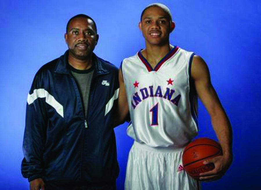 Eric Gordon poses with his dad Eric Sr. after winning the