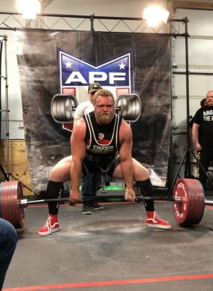 Coach Connor Karwowski attempts a heavy deadlift at a competition. Karwowski is the strength and conditioning coach.
