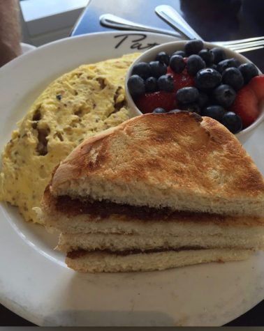 The three egg omelet is served with two sides. Cafe Patachou is located on River Crossing Blvd. in Indianapolis.