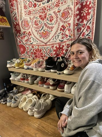 Katie Lough poses with her broad shoe collection. Lough has many Nike sneakers, among others.