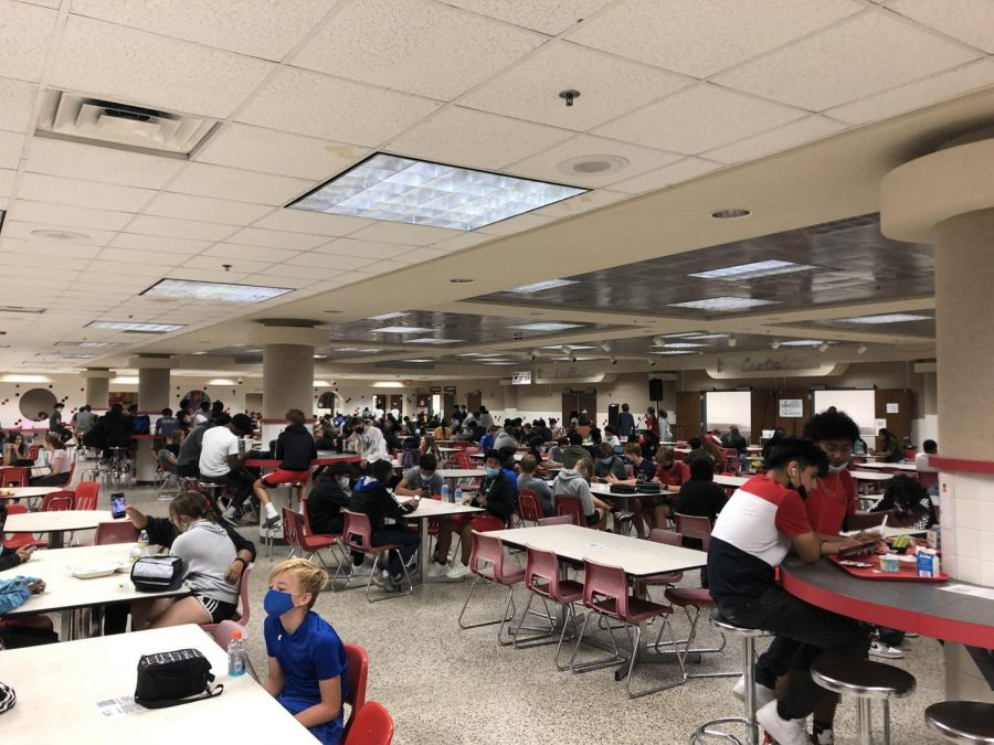 Students sit either four or six to a table, respecting the new seating policy. Each day they scan the QR code at their table for attendance.