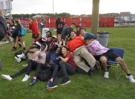 Paul Loggan sits on the soccer couch with upperclassmen from the student section. Each year upperclassmen get the opportunity to enjoy the game from the seats of a comfortable couch.