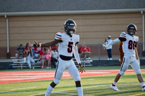 TJ McWilliams has multiple division one offers. He lines up against Fishers ready to receive the ball.
