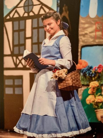 Melton plays the lead role in a musical. Melton is used to singing and dancing on stage, which helps her prepare for different roles.