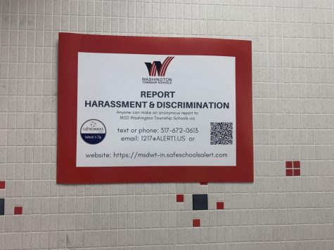 Posters with information about how to contact the harassment and bullying tip line are hung up around the school.