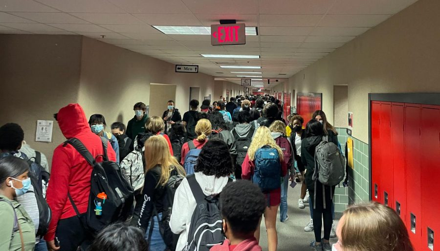 Students+walk+down+upper+J+hall+on+their+way+to+class.+With+only+one+bell%2C+the+hallways+are+more+crowded++and+it+takes+longer+for+students+to+get+to+class.+